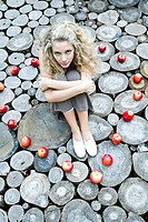 Young woman sitting in apples ring (thumbnail)