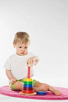 Baby playing with education toy (thumbnail)