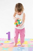 baby girl playing with bricks, letters and numbers