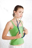 woman holding stethoscope