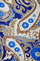Close_up of colorful vintage fabric with blue and brown paisley printed on polyester