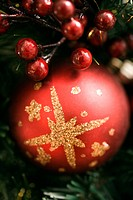 Close up of red ornament and berries on Christmas wreath (thumbnail)