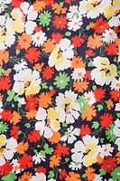 Close_up of vintage fabric with colorful flowers printed on polyester