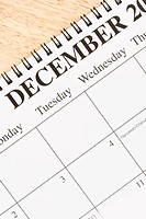 Close up of spiral bound calendar displaying month of December