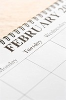 Close up of spiral bound calendar displaying month of February
