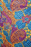 Close_up of colorful vintage fabric with flowers and shapes printed on polyester