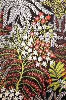 Close_up of vintage fabric with red green and white flowers printed on polyester