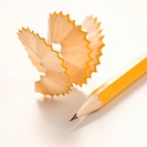 Sharp pencil next to spiral pencil shavings