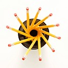 Top view of group of pencils in pencil holder arranged in a spiral shape