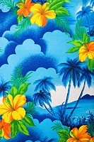Close_up of bright blue Hawaiian vintage fabric with orange hibiscus flowers printed on polyester