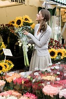 Young woman in flower market