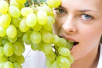 closeup of a woman with grapes