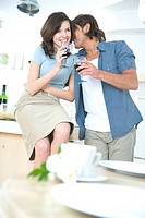 couple drinking wine in kitchen
