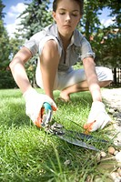 woman cutting grass