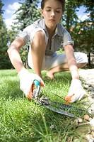 woman cutting grass
