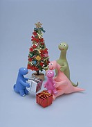 A Family Of The Dinosaur Surrounding A Christmas Tree