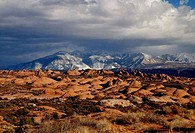 Clouds over a mountain range, Arches National Park, Utah, USA