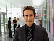 Businessman posing in corridor