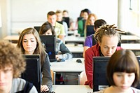 Students in classroom sitting at computer stations