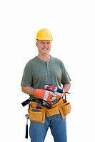 Male builder with hardhat and electric drill, smiling, portrait, cut out (thumbnail)
