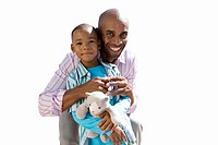 Father embracing son, smiling, portrait, cut out (thumbnail)