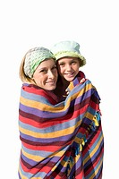 Mother and daughter wrapped in blanket, smiling, portrait, cut out (thumbnail)
