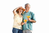Senior couple, holding cocktails, laughing, cut out (thumbnail)