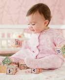 Mixed race baby girl playing with alphabet blocks (thumbnail)