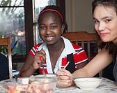 Teenage girls eating fruit salad