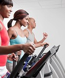 African people using exercise equipment in health club (thumbnail)