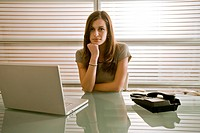 Businesswoman at desk (thumbnail)