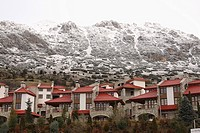 View of Arachova town and snowy mountains in the background. Kellaria, Parnassos, Arachova, Viotia, Central Greece, Europe