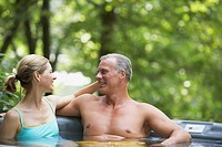 Couple Soaking in Hot Tub