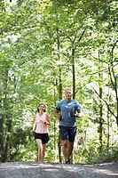 Couple Jogging Through Woods
