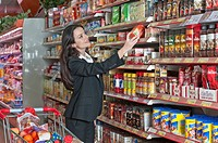 woman taking product off supermarket she