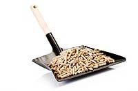 Wood pellets on Dustpan, close_up