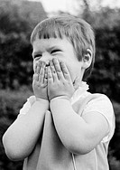 Sixties, black and white photo, people, children, little girl buries his face in his hands and laughs, aged 3 to 5 years, Elke