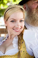 Germany, Bavaria, Upper Bavaria, Young woman in traditional costume, smiling, portrait, close_up