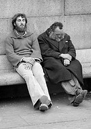 Seventies, black and white photo, people, two homeless men side by side on a bench, sleeping, depressed, aged 25 to 35 years, aged 50 to 60 years, Gre...