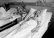 Eighties, black and white photo, people, health, young woman lies in a sickbed of a hospital, aged 30 to 40 years, Elisabeth