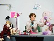 Woman with soft toys in office