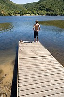 Teenage boy on a jetty