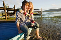 Teenage couple with boat
