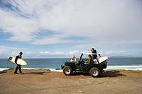 Surfers with off road vehicle