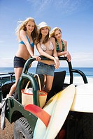 Girls with vehicle and surfboards