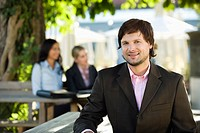 Germany, Bavaria, Upper Bavaria, Young businessman in beer garden, portrait