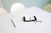 Eyeglasses and diary on a table