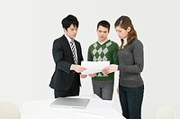 Businesspeople looking at paperwork