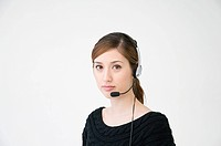A woman wearing a telephone headset