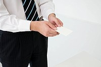 Businessman holding businesscards